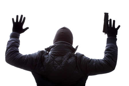 taking risks: A criminal giving up by holding his hands up