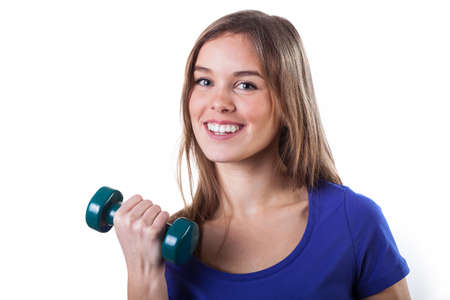 Beautiful happy young girl exercising to keep fit photo
