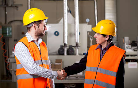 Female worker shake hand with male worker