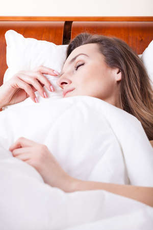 cloesup: Cloesup of a woman sleeping in bed