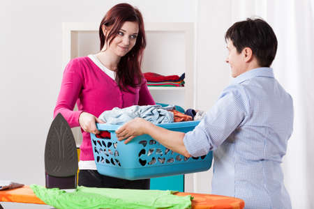 house chores: Mother and daughter during sharing house chores