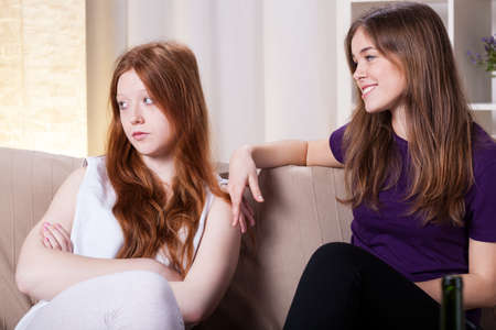 dissapointed: Two friend on a couch during quarrel