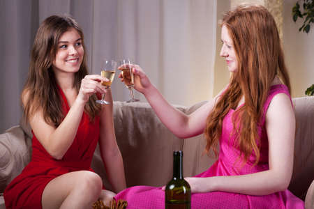 lesbians: Elegant girls celebrating an occasion with champagne
