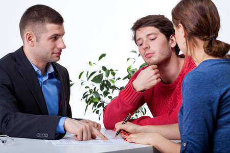 causasian: A couple on a business advisory meeting with a specialist
