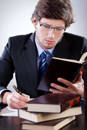 Lawyer reading code and  preparing for the court case photo