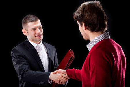 professionalist: A smiling businessman shaking hands with his client