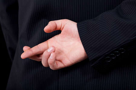 lier: A closeup of a man doing a cheating gesture with his hand