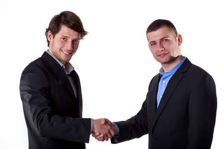 professionalist: Two young smiling businessman shaking hands in agreement