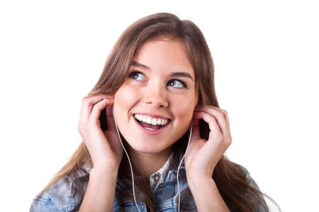 ballad: Young girl with white phones listening to music Stock Photo