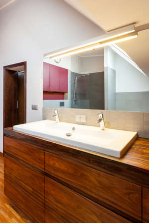 Bathroom interior, countertop with white ceramic sink photo