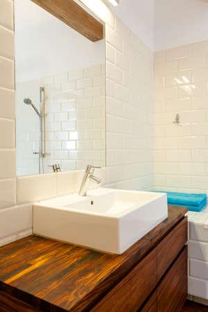 vessel sink: Vanity basin, mirror and towels in bathroom