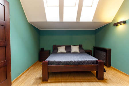 Modern bedroom in the attic in turquoise wall colors photo