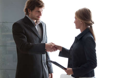 Partners in business shaking their hands after succesful meeting. photo