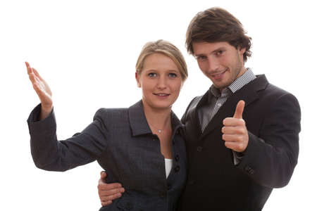 Business man embracing woman working with him, showing the ok gesture photo