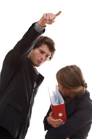 Angry employer firing his employee, holding folders. photo