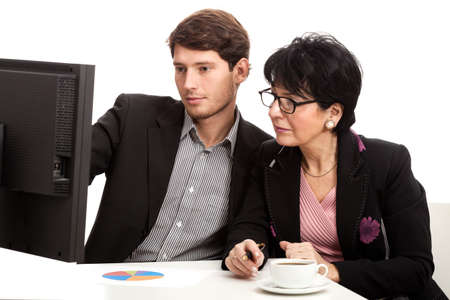 Coworkers during analysing computer data in office Stock Photo