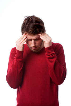 throe: Young man with strong headache on isolated background