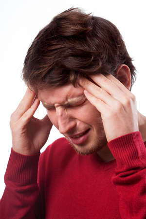 throe: Young man suffering from migraine on isolated background Stock Photo