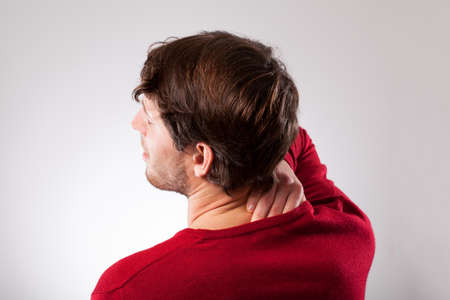 throe: Young man suffering from neck pain, horizontal