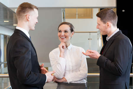 Business team chatting and smiling at office photo