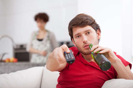 lazybones: Husband doesnt help his wife at home Stock Photo
