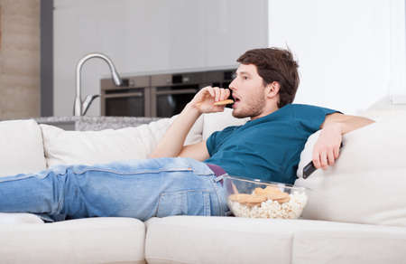 lazy: Handsome man resting after work at home Stock Photo