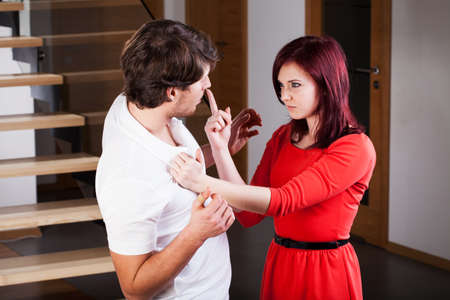 threaten: An agressive woman threatening her boyfriend