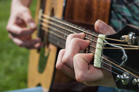 guitar pick: A close up of a musicians hand Stock Photo