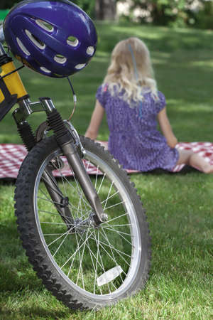 Picnic recreation after bike riding on a blanket in the park photo