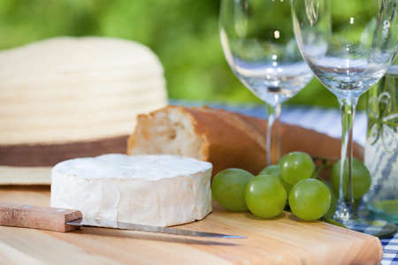 Fresh snacks; camembert, grapes and a baguette photo