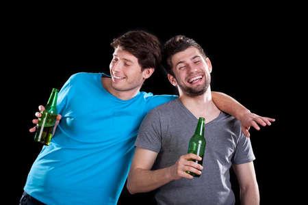 孤立した背景にパーティーの後酔って男性の友人 写真素材