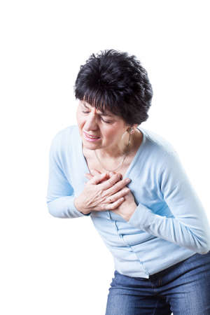 sternum: An elderly women suffering from a pain in the chest Stock Photo