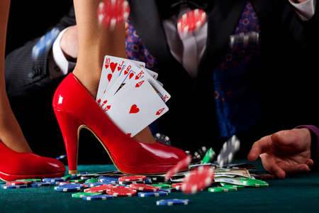 A royal flush of hearts in a red pump Stock Photo