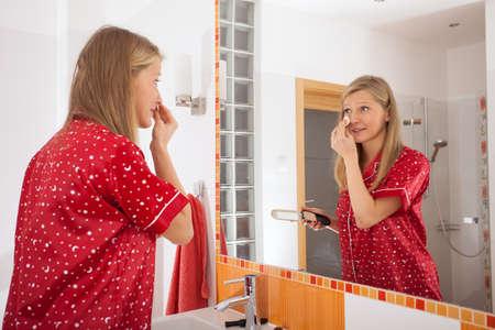pj's: A woman applying a facial powder on her face