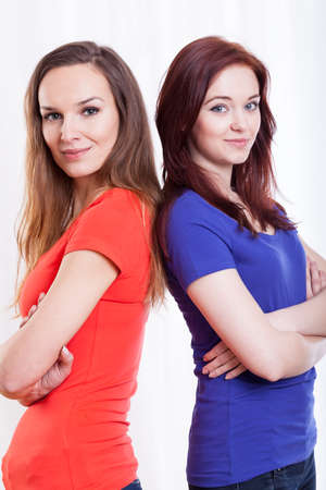founded: Happy female friends standing with founded hands Stock Photo