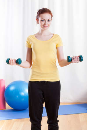 Woman training her arms at the gym photo