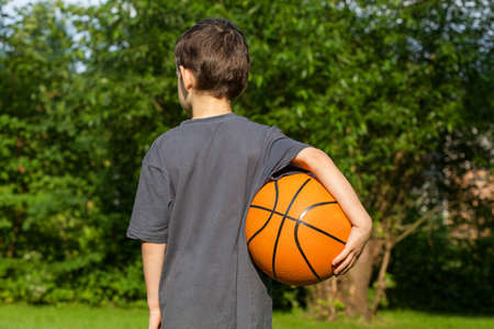 rivals rival rivalry season: Summer playing in the garden with ball Stock Photo
