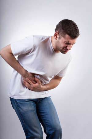 stomach: Young man suffering from stomach ache