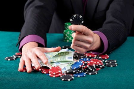 gamblers: Gamblers hands with casino chips and banknotes