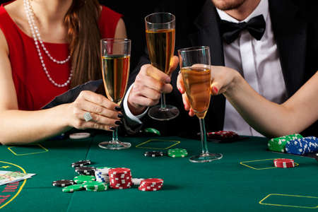 proposing a toast: Casino players proposing a toast with a glass of champagne