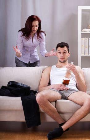 lazybones: Lazy man ignoring his girlfriends words,vertical