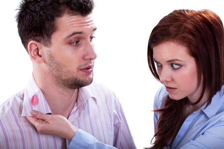 betray: Wife found a lipstick kiss on shirt collar of husband Stock Photo