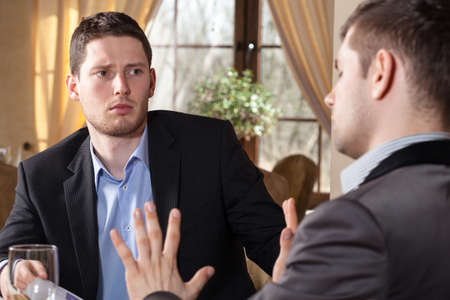 Businessman on meeting in restaurant discussing about project photo
