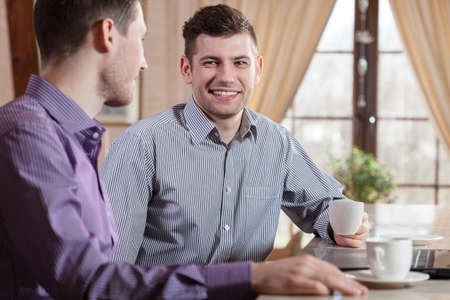 Two businessmen at meeting on a coffee photo