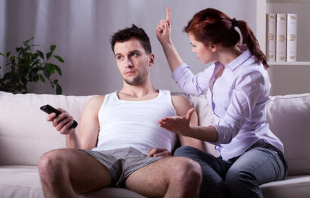 lazybones: Young woman threatening husband at home