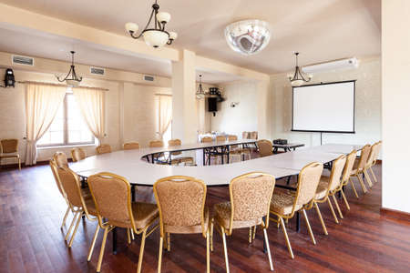 Conference room with round table and projector