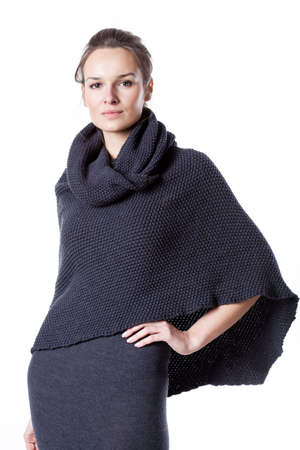 Woman wearing woollen turtleneck on isolated background