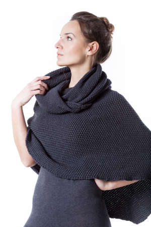 Thoughtful woman wearing turtleneck on isolated background Reklamní fotografie