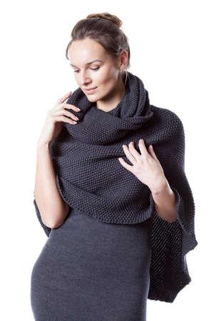 Pretty lady wearing woollen dress with turtleneck Reklamní fotografie