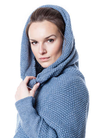 Beautiful woman wearing hooded sweater on isolated background photo